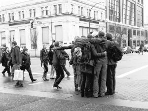 Group of strangers hugging (Photo: Joris Louwes)